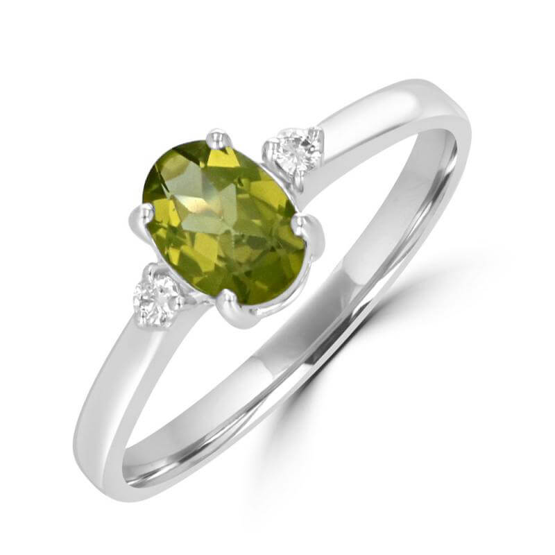 5X7 OVAL PERIDOT AND ONE DIAMOND ON EACH SIDE RING