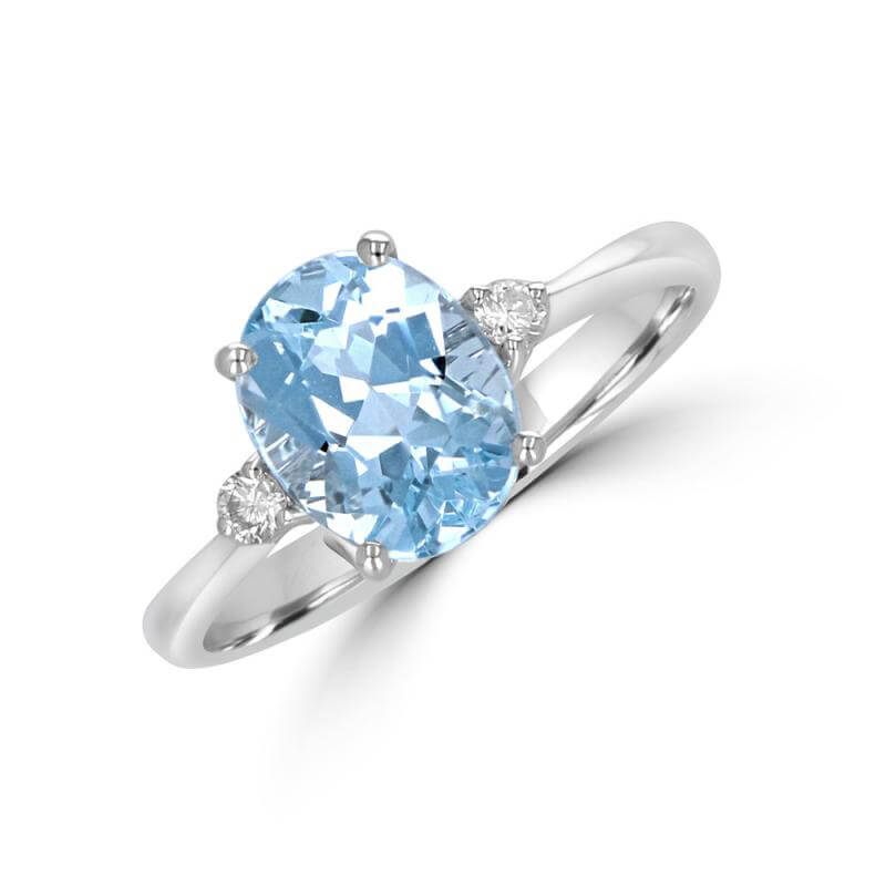 7X9 OVAL AQUAMARINE WITH ROUND DIAMOND ON EACH SIDE RING