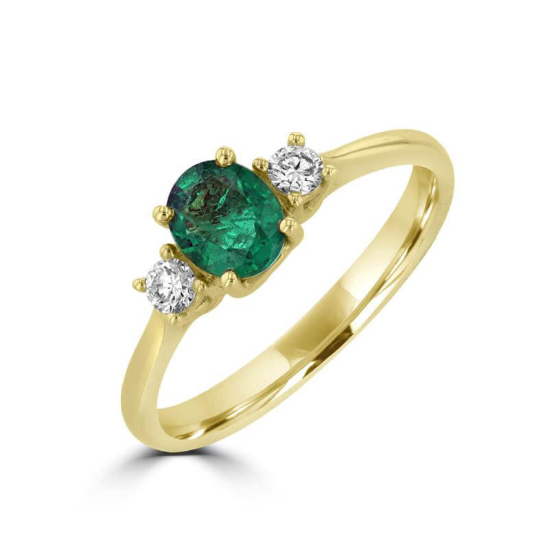 OVAL EMERALD WITH DIAMOND ON EACH SIDE RING