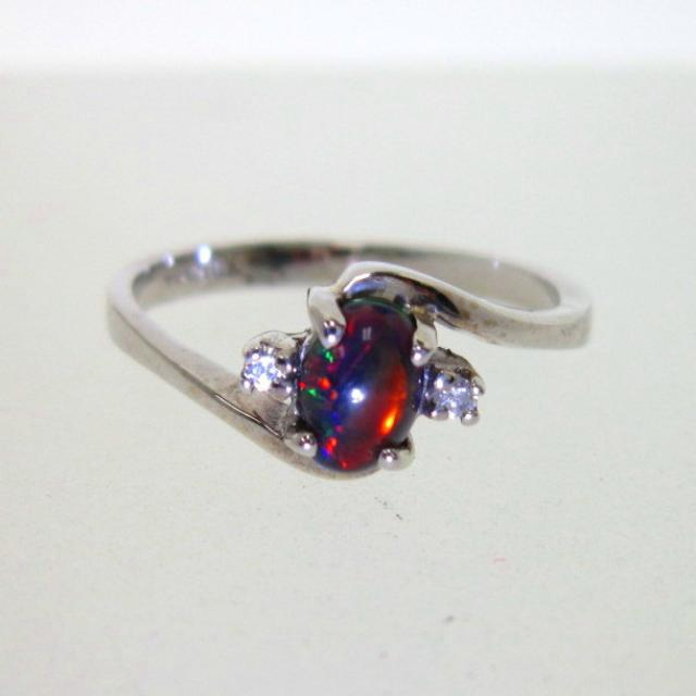 JCSJCS1378: This made in the USA 10k white gold ring is set with a Lab Created Black Opal with beautiful flashes of red and orange. Unleash your passion!...SOLD