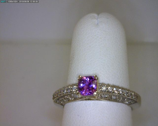 Add some color to your engagement ring with this pretty pink sapphire, accented with diamonds.  R...