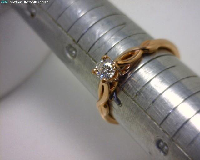 Infinity inspired 14kt rose gold diamond engagement ring.  Features a 1/3 ct round brilliant cut ...
