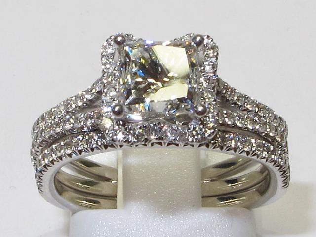 JCS574: 14k White Gold Engagement & Matching Wedding Band Set With 99 Round Accent Diamonds & 1.02 Carat Princess Cut Center Diamond.