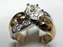 JCS567: 14 Karat 2-tone Contemporary Diamond Ring With One 1.05Ct Oval Center Diamond And 6 Accent Diamonds