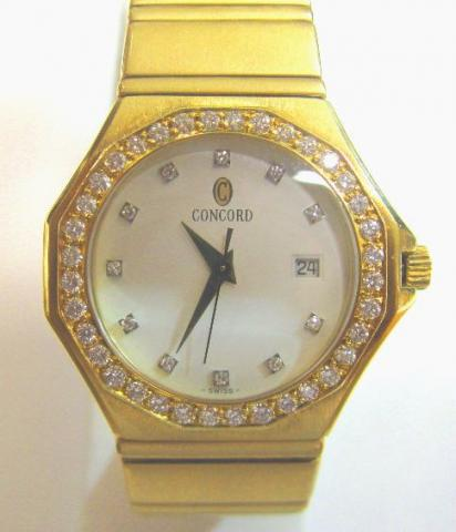 JCSA905: Ladies estate Concord watch in 18kt. yellow gold.  The quartz movement watch has a diamond dial and bezel with date and second hand.  Total weight is 115 grams.