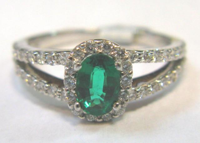 JCSA908: Gorgeous estate emerald ring. Oval emerald (approx. 6 X 4mm's) .50cts. and .56cts. of diamonds, 18kt white gold.